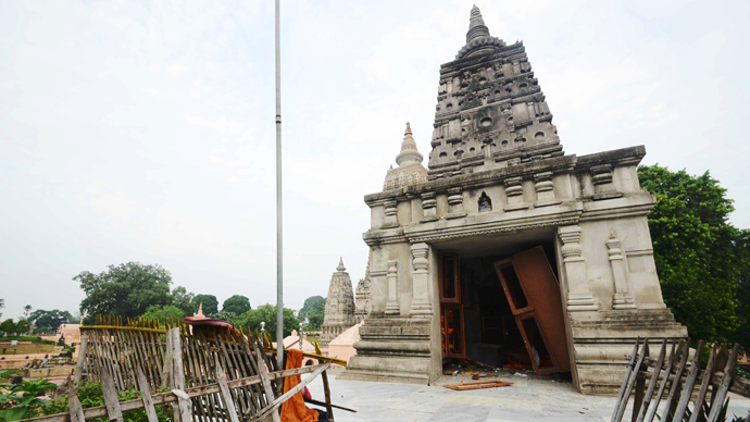The entrance to a Budhist temple edifice at the Bodh Gaya Buddhist temple complex appears torn apart after several low intensity explosions took place injuring two people on July 07,2013 (AFP Photo / STR)