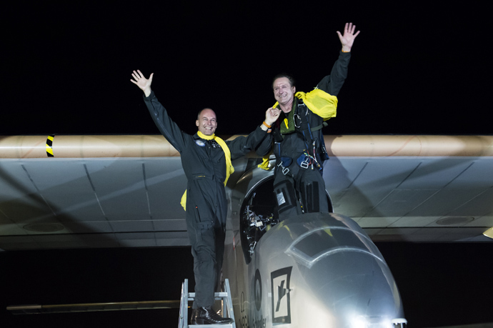 This handout picture shows Solar Impulse Chairman and pilot Bertrand Piccard (L) and Solar Impulse CEO and pilot Andre Borschberg posing after Solar Impulse HB-SIA planes landed in JFK airport on late July 6, 2013 in New York (AFP Photo / Fred Merz)