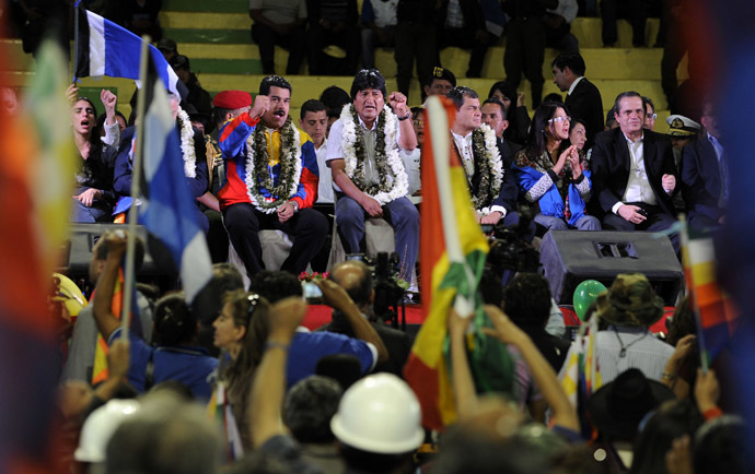 Bolivia's President Evo Morales (C) and his counterparts Nicolas Maduro (C left) of Venezuela and Rafael Correa (C, right) of Ecuador, are pictured during a welcoming gathering in honour of Morales, in Cochabamba, on July 4, 2013. (AFP Photo/Jorge Bernal)