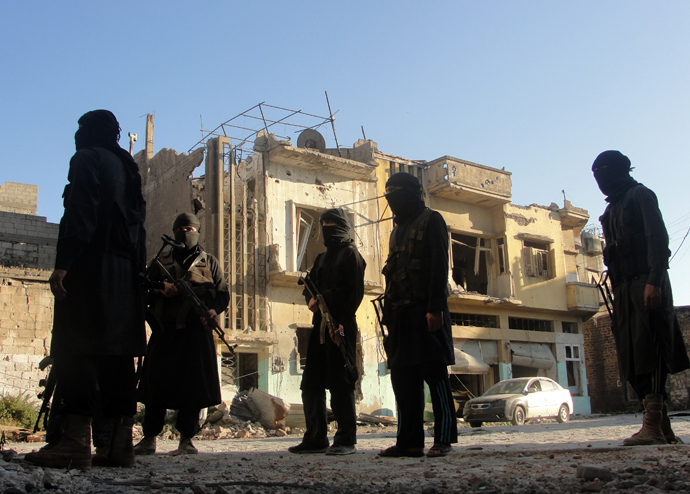 A handout picture released by the opposition-run Shaam News Network on July 2, 2013 shows rebel fighters scouting the area in Syria's central city of Homs (AFP Photo / HO / Shaam News Network)