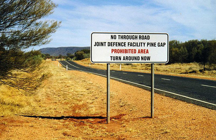 Warning sign on the road to Pine Gap (Image from wikipedia.org)