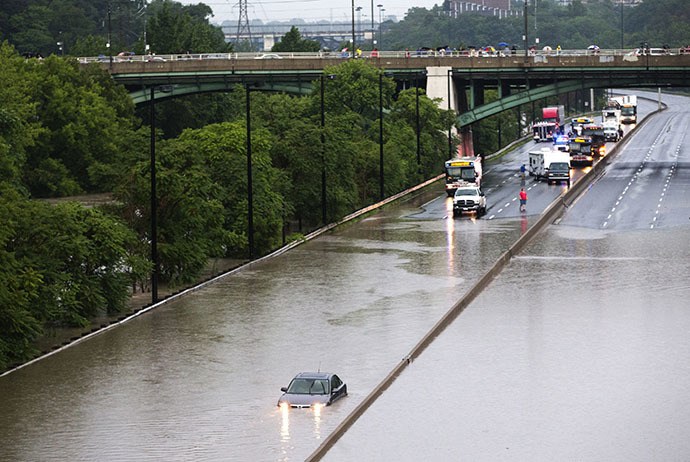 A car is stuck during a flood on the Don Valley Parkway, a major highway, during a heavy rainstorm in Toronto, July 8, 2013. (Reuters / Mark Blinch)