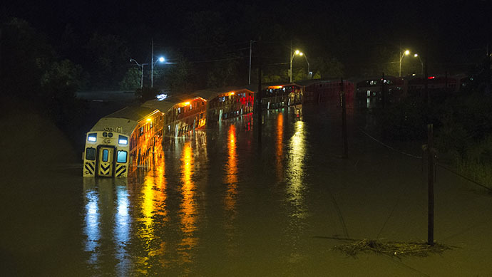 A Go Train, a commuter train, with passengers waiting to be rescued inside, is stuck in flood waters during a heavy rainstorm in Toronto, July 8, 2013. (Reuters / Mark Blinch)