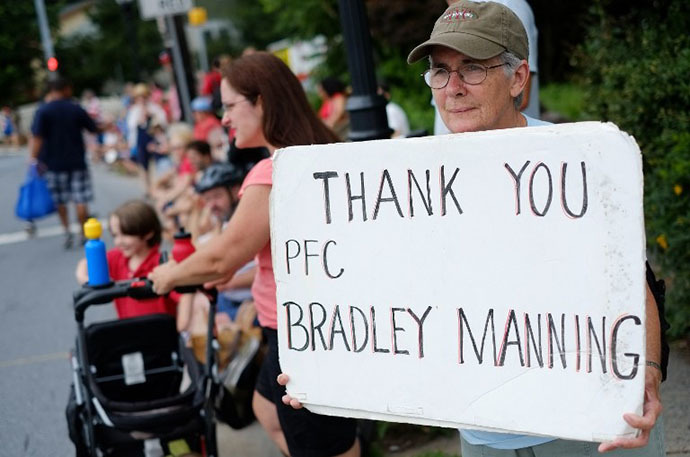 A woman shows her support for Bradley Manning during the Independence Day parade in Takoma Park, Maryland on July 4, 2013. (AFP Photo / Mandel Ngan)