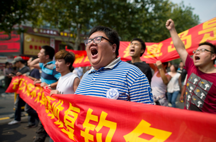 "Chinese demonstrators shout slogans during a protest against Japan's ""nationalizing"" of Diaoyu Islands, also known as Senkaku in Japan, in Hangzhou, east China's Zhejiang province, on Septermber 18, 2012 (China out / AFP Photo)"