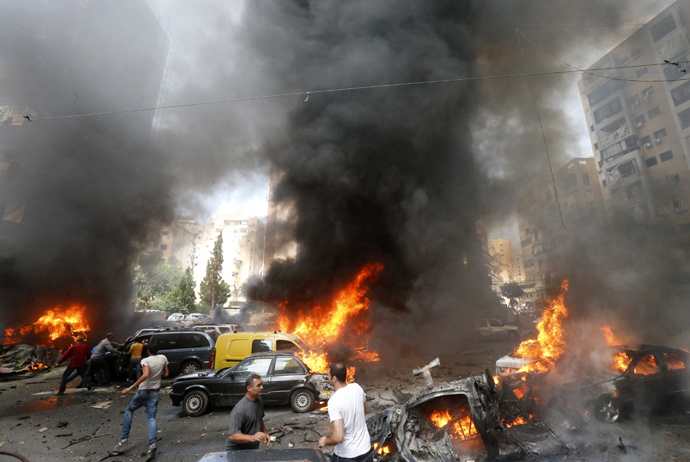 Civilians gather at the of an explosion in Beirut's southern suburb neighbourhood of Bir al-Abed on July 9, 2013 (AFP Photo / Str)