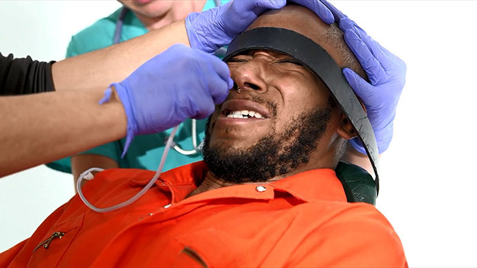 Shock video ft. Mos Def reenacts gruesome Gitmo-style force-feeding