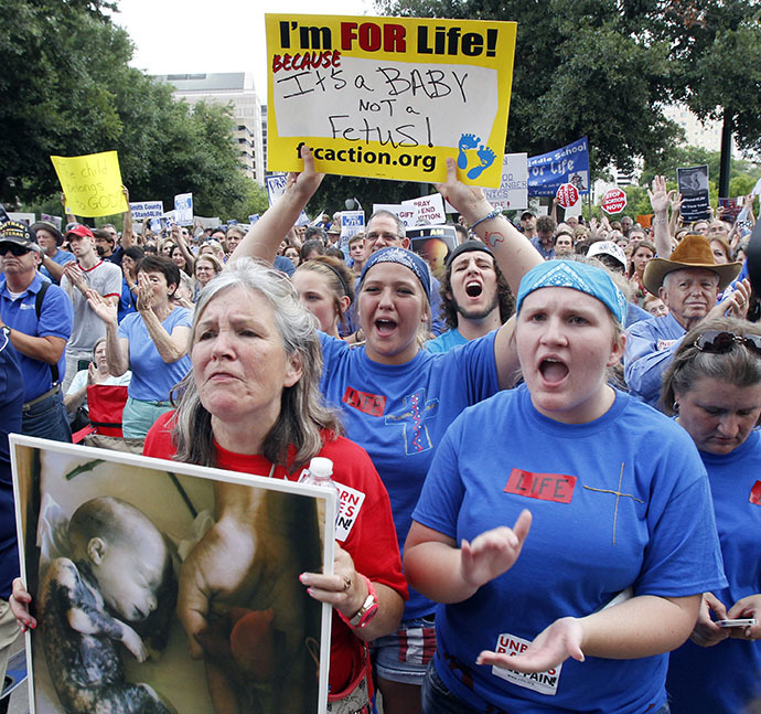 Protesters hold signs and shout during an anti-abortion rally at the State Capitol in Austin, Texas, July 8, 2013. (Reuters / Mike Stone)