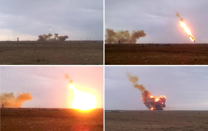 The Proton-M carrier-rocket with its DM-03 upper stage and three Russian Glonass-M satellite navigation systems seen falling down after its take-off from the Baikonur space center. Composition of four photos. (RIA Novosti/Yuri Aliseenko)