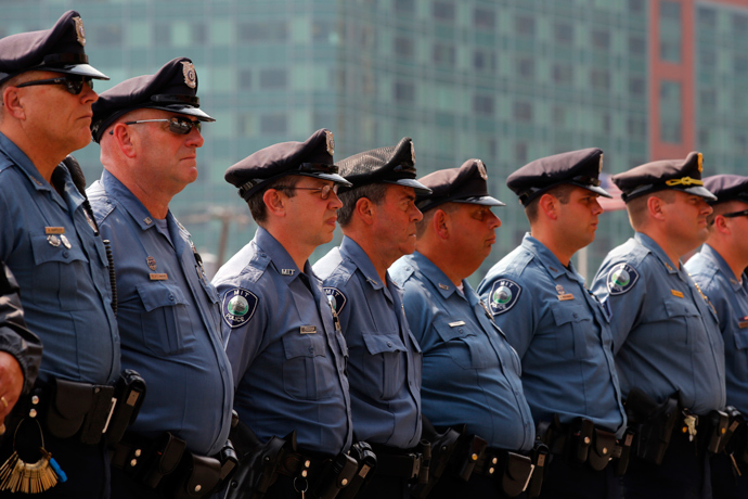 Massachusetts Institute of Technology (MIT) police officers stand outside the federal courthouse for the court appearance by accused Boston Marathon bomber Dzhokhar Tsarnaev in Boston, Massachusetts July 10, 2013 (Reuters / Brian Snyder)