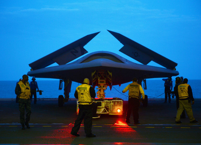 This May 13, 2013 US Navy handout image shows an X-47B Unmanned Combat Air System (UCAS) demonstrator being towed into the hangar bay of the aircraft carrier USS George H.W. Bush (CVN 77) during operations in the Atlantic Ocean. (AFP Photo/US Navy)