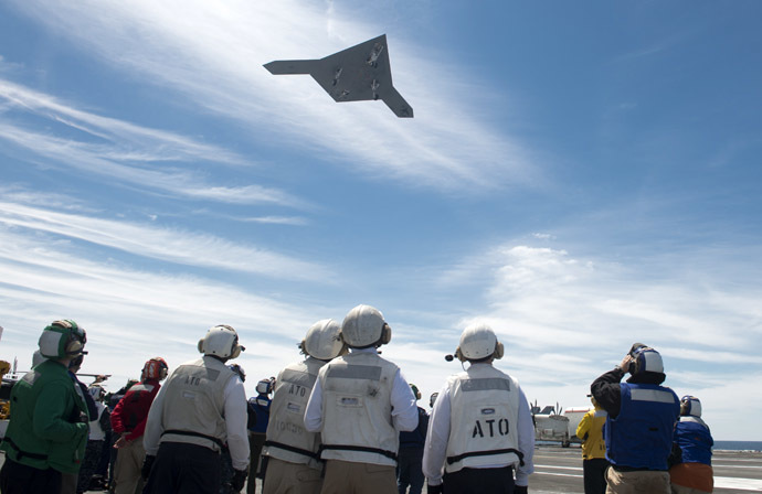 This May 14, 2013 US Navy handout image shows an X-47B Unmanned Combat Air System (UCAS) demonstrator flying over the flight deck of the aircraft carrier USS George H.W. Bush (CVN 77) during operations in the Atlantic Ocean. (AFP Photo/US Navy)