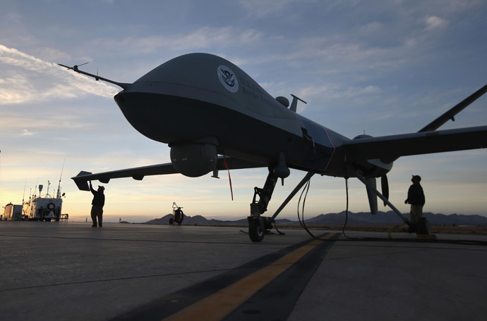 Maintenence personel check a Predator drone operated by U.S. Office of Air and Marine (OAM), before its surveillance flight near the Mexican border on March 7, 2013 from Fort Huachuca in Sierra Vista, Arizona. (John Moore/Getty Images/AFP)