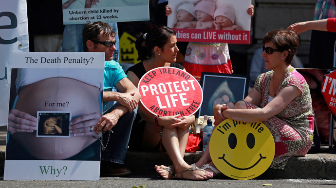 Pro-Life campaigners demonstrate outside the Irish Parliament ahead of a vote to allow limited abortion in Ireland, Dublin July 10, 2013 (Reuters / Cathal McNaughton)