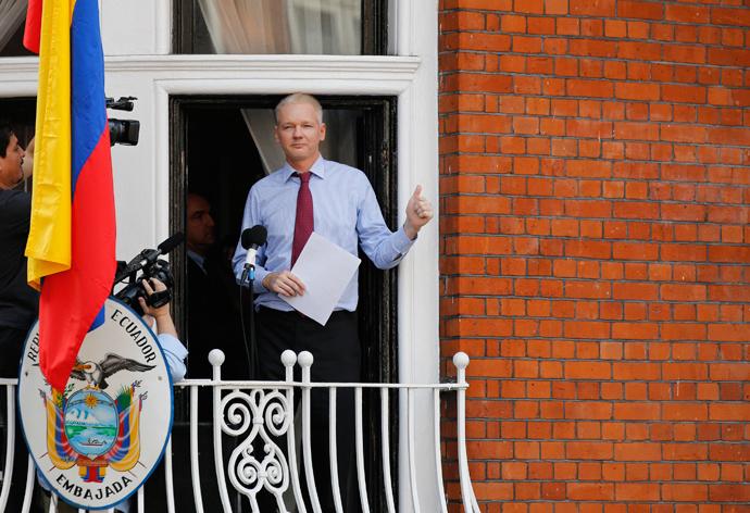Wikileaks founder Julian Assange gestures as he appears to speak from the balcony of Ecuador's embassy, where he is taking refuge in London (Reuters / Chris Helgren)