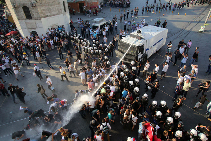 Riot police use a water cannon to disperse demonstrators during a protest at Taksim Square in central Istanbul (Reuters / Serkan Senturk)