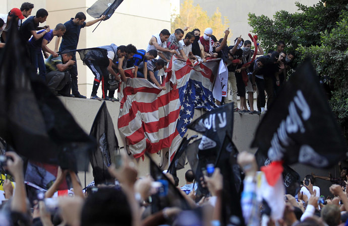 Protesters destroy an American flag pulled down from the U.S. embassy in Cairo September 11, 2012. (Reuters/Mohamed Abd El Ghany)