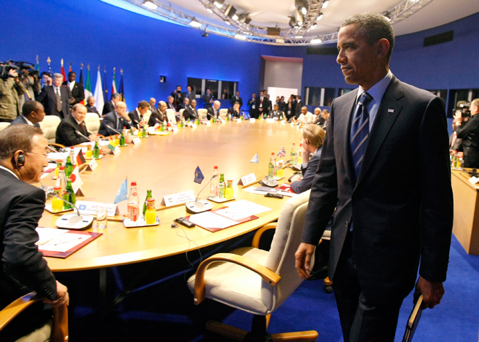U.S. President Barack Obama prepares to take his seat for a round table meeting G8 members (Reuters / Remy De La Mauviniere)
