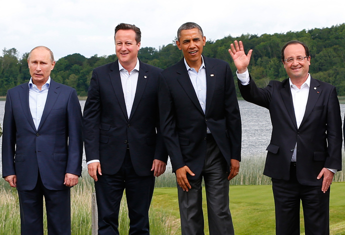 Country leaders (L-R) Russia's President Valdimir Putin, Britain's Prime Minister David Cameron, U.S. President Barack Obama and France's President Francois Hollande attend a family photo at the G8 Summit, at Lough Erne, near Enniskillen, in Northern Ireland June 18, 2013 (Reuters / Yves Herman)