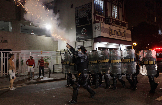 "Riot police fire tear gas during clashes with demonstrators during the ""National Day of Strikes, Stoppages and Protests"" near Rio de Janeiro's governmental Guanabara Palace July 11, 2013 (Reuters / Ricardo Moraes)"