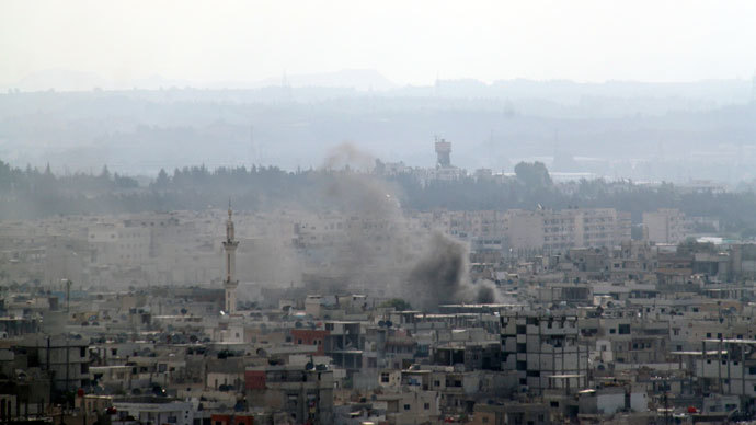 Smoke rises in the city of Latakia.(Reuters / Handout)