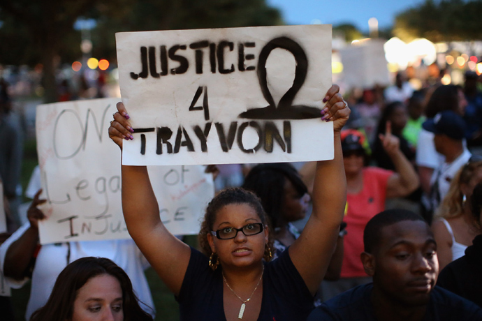 Supporters of Trayvon Martin wait in front of the Seminole County Criminal Justice Center for the verdict to be announced in the George Zimmerman murder trial on July 13, 2013 in Sanford, Florida (AFP Photo / Scott Olson)