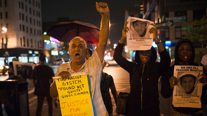Protesters gesture as they rally in response to the acquittal of George Zimmerman in the Trayvon Martin trial, in the Harlem neighborhood of New York July 14, 2013 (Reuters / Keith Bedford)