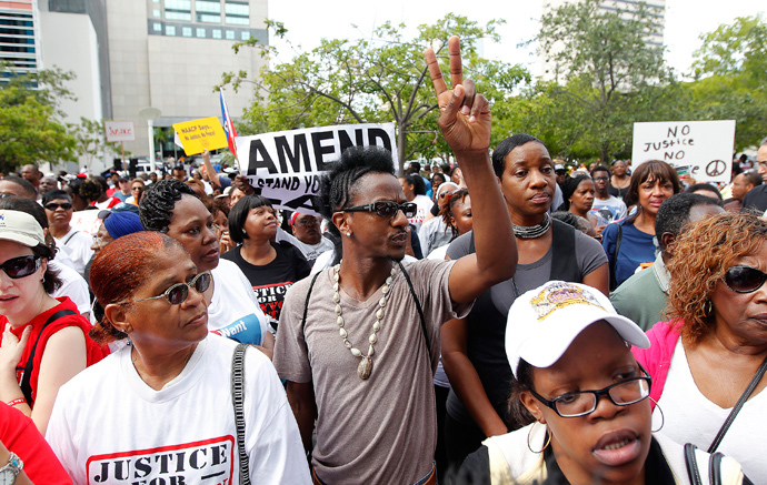 People attend a rally led by Tracy Martin, father of Trayvon Martin, in Miami, Florida July 20, 2013 (Reuters / Andrew Innerarity)