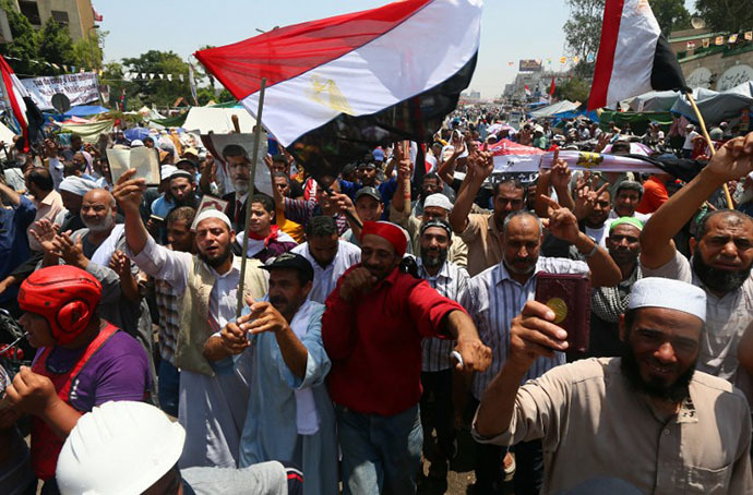 Supporters of Egypt's deposed president Mohamed Morsi chant islamic slogans during a rally outside Cairo's Rabaa al-Adawiya mosque on July 13, 2013. (AFP Photo / Marwan Naamani)