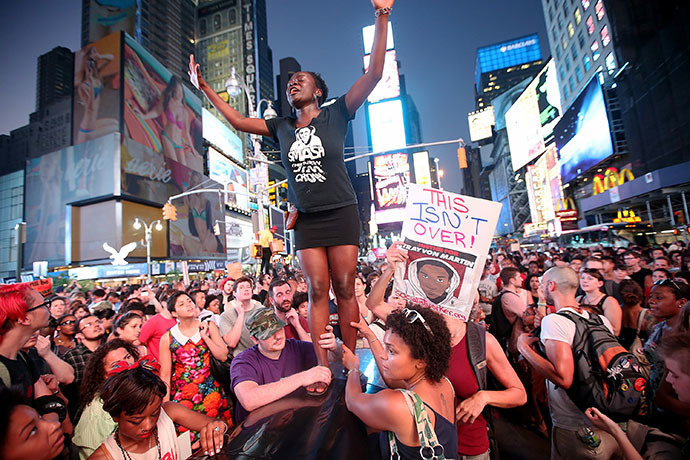 Trayvon Martin supporters rally in Times Square while blocking traffic after marching from a rally for Martin in Union Square in Manhattan on July 14, 2013 in New York City. (AFP Photo / Mario Tama)