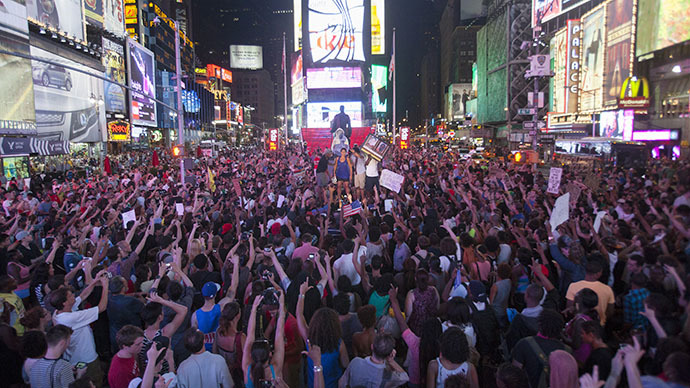 Protesters rally in response to the acquittal of George Zimmerman in the Trayvon Martin trial in Times Square in New York, July 14, 2013. (Reuters / Keith Bedford)