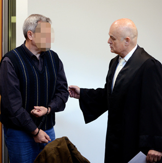 German (codenamed) Andreas Anschlag talks to his lawyer at court on January 15, 2013 in Stuttgart, southern Germany (AFP Photo)