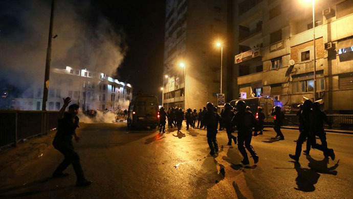 Egyptian riot police disperse supporters of the Muslim Brotherhood and Egypt's ousted President Mohamed Morsi block on July 16, 2013 near the Six October bridge in the center of Cairo. (AFP photo / Marwan Naamani)