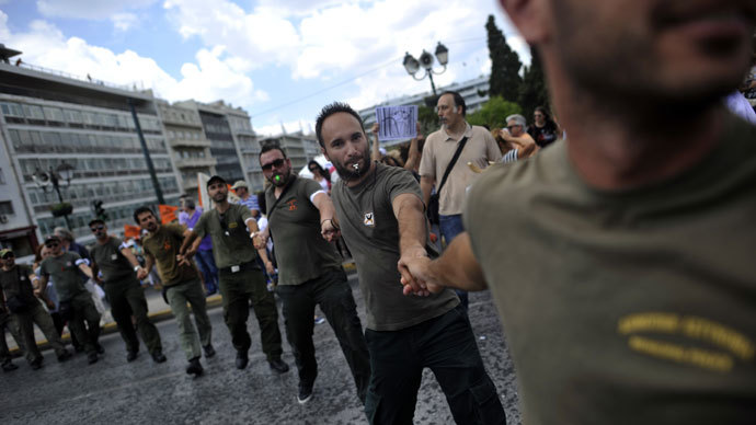 Municipal police members demonstrate on July 16, 2013 in front of the parliament during a general strike in Athens. (AFP Photo / Aris Messinis)