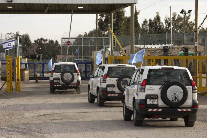 UN peacekeeper vehicles cross the Quneitra checkpoint between Israel and Syria (AFP Photo / Jack Guez)