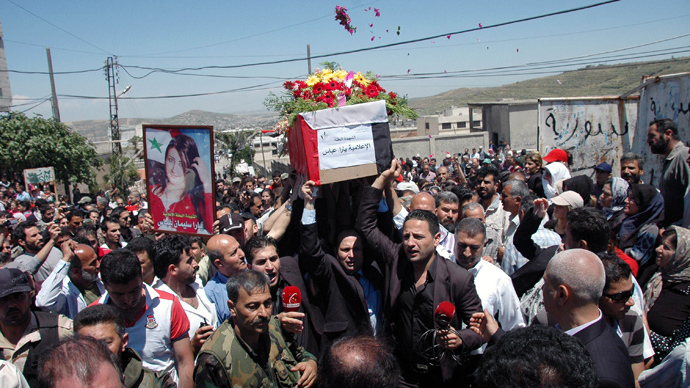 Mourners carry the coffin of Yara Abbas, a reporter for the al-Ikhbariya news channel, during her funeral in Nisyaf village in the countryside of Hama city, Syria (SANA / Handout via Reuters)