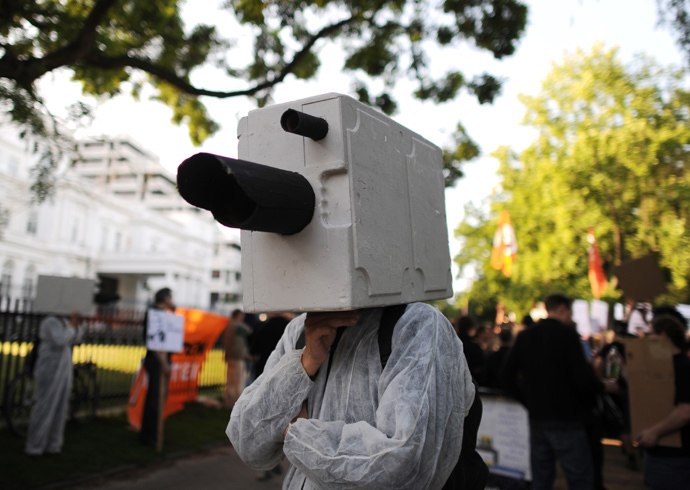 A demonstrator dressed up as a surveillance camera attenda a demonstration in support of U.S intelligence contractor Edward Snowden who leaked the US National Security Agenca (NSA) surveillance program, under the motto 'Stop Prism now!' in front of the US consulate in Hamburg, Germany (AFP Photo / DPA / Angelika Warmuth / Germany out)