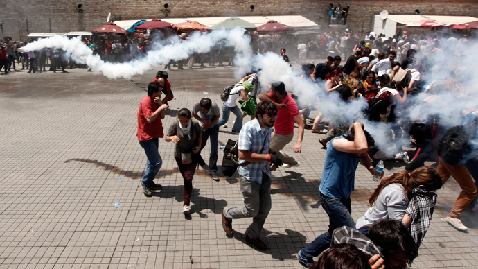 Riot police use tear gas to disperse the crowd during an anti-government protest at Taksim Square in central Istanbul May 31, 2013 (Reuters / Osman Orsal)