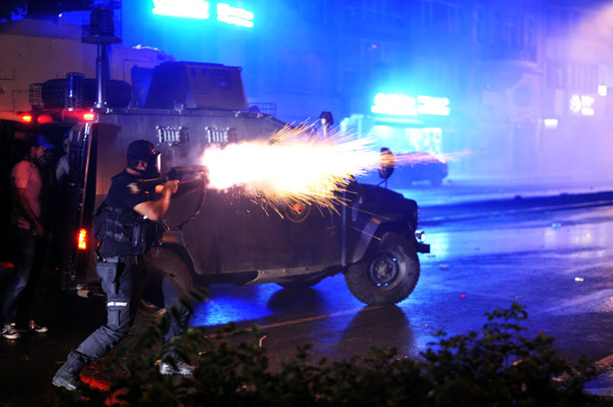 Riot police fires tear gas bomb to disperse protesters at Harbiye near Taksim square in Istanbul, on June 16, 2013. (AFP Photo/Ozan Kose)
