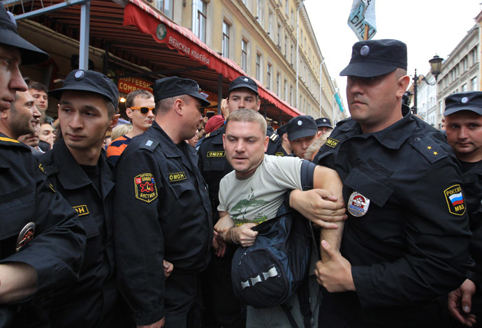 Policemen detain a participant of the protest rally in support of Aleksei Navalny. (RIA Novosti/Igor Russak)