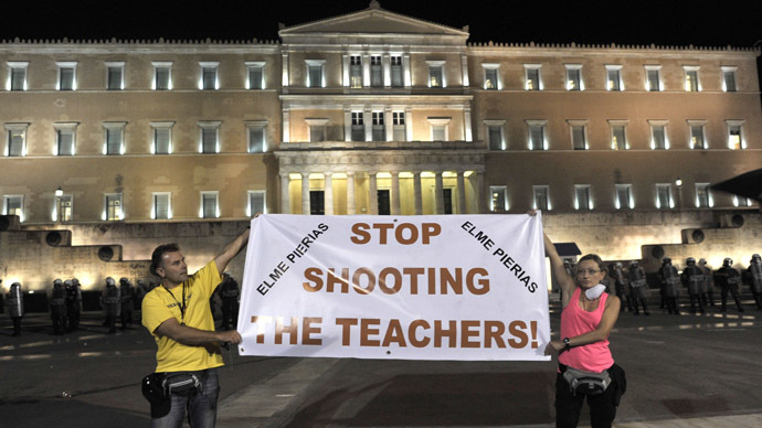 Austerity in action: Greece approves to lay off 25,000 teachers, police