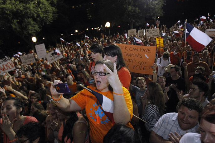 Abortion rights protesters rally after the state Senate passed legislation restricting abortion rights in Austin, Texas early July 13, 2013. (Reuters/Mike Stone)