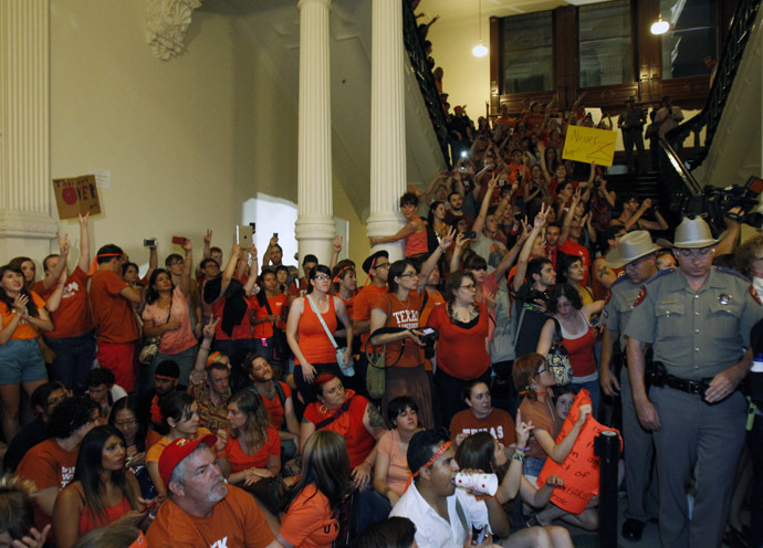 Abortion rights protesters rally inside the State Capitol after the state Senate passed legislation restricting abortion rights in Austin, Texas, July 13, 2013. (Reuters/Mike Stone)