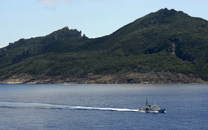 A Japan Coast Guard patrol ship sails around Uotsuri island, part of the disputed islands in the East China Sea, known as the Senkaku isles in Japan, Diaoyu islands in China (Reuters/Kyodo)