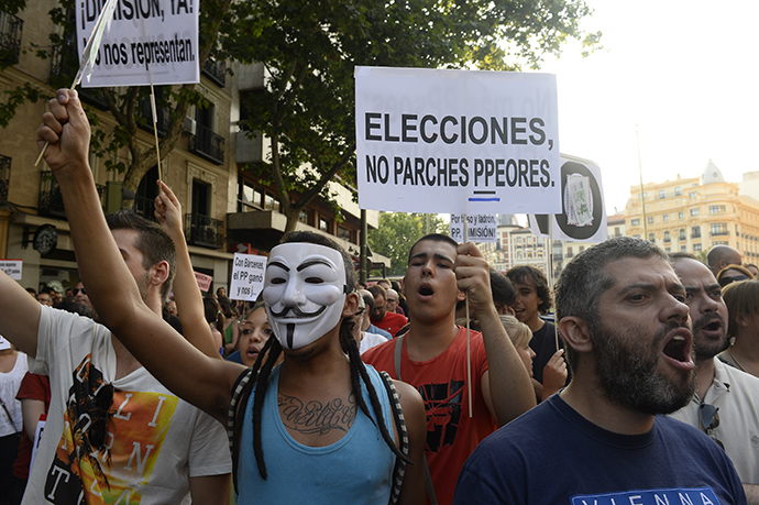 "People hold a poster reading ""Elections, no worst patch"" as they protest against Spanish Prime Minister Mariano Rajoy outside the headquarters of the PP (Popular Party) in Madrid on July 18, 2013. (AFP Photo / Pierre-Philippe Marcou)"