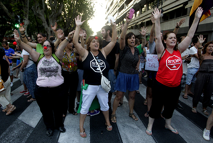 Protesters block the Gran Via Avenue during a demonstration against the People's Party (Popular Party) in Valencia, July 18, 2013. (Reuters / Heino Kalis)