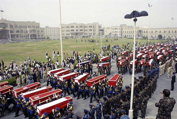 Soldiers carry coffins during the funeral of dozens of soldiers killed in Monday's suicide bombing in Sanaa May 24, 2012. (Reuters)