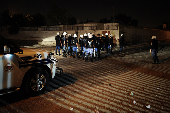 Bahraini policemen gather during clashes with demonstrators following a protest to demand more rights and against the ruling regime in the village of Diraz, West of Manama, in the early hours of July 19, 2013. (AFP Photo / Mohammed Al-Shaikh)