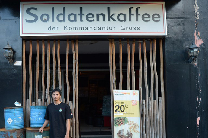 "Owner Henry Mulyana standing outside the Soldatenkaffe ""The Soldiers' Cafe"" in Bandung. (AFP Photo / Adek Berry)"