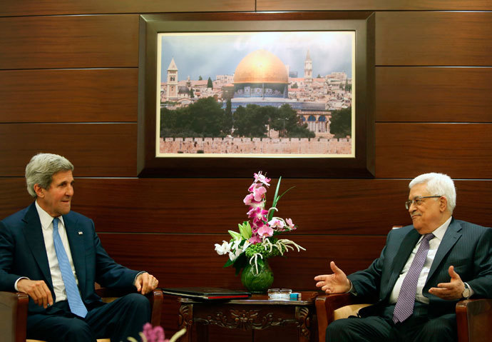 U.S. Secretary of State John Kerry (L) meets with Palestinian President Mahmoud Abbas at the Mukataa compound, in the West Bank city of Ramallah July 19, 2013.(Reuters / Fadi Arouri)